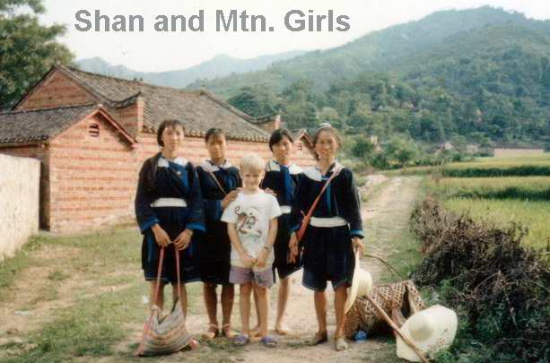 Shannon, our oldest son, with some minority girls in northern Guangdong province   Amoy Magic Guide to Xiamen and Fujian