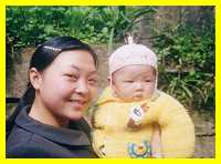 Proud young Hakka mother and child