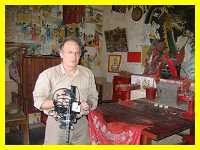 Len McClure filming inside a  small shrine for a local god