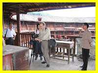 Len McClure filming inside a Hakka earthen castle
