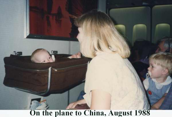 Susan Matthew (in basket) and Shannon on the plane to Hong Kong in August 1988 (Matt was five months old)